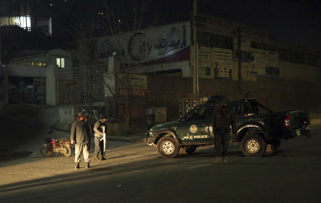 <p>Policemen block the main road near the Intercontinental Hotel after a deadly attack in Kabul, Afghanistan, Jan. 20, 2018. (Photo: Massoud Hossaini/AP) </p>