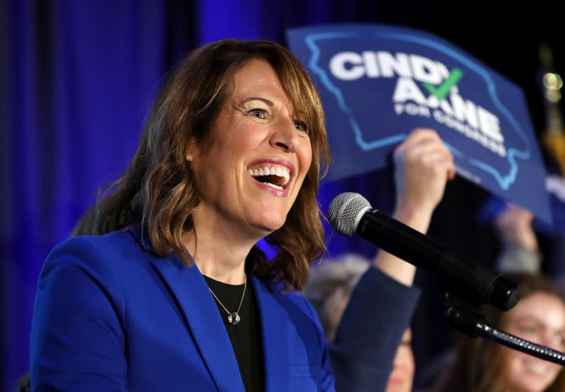 Democratic congressional candidate Cindy Axne reacts while appearing at her midterm election night party in Des Moines