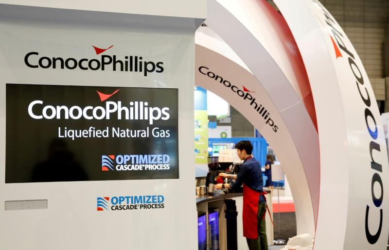 FILE PHOTO: Logos of ConocoPhillips are seen in its booth at Gastech, the world's biggest expo for the gas industry in Chiba