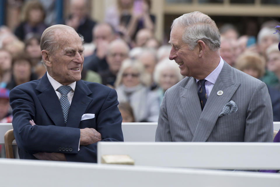 POUNDBURY, ENGLAND - OCTOBER 27: Britain's Prince Philip, Duke of Edinburgh (L) and Prince Charles, Prince of Wales (R) listen to speeches before a statue of the Queen Elizabeth, The Queen Mother was unveiled on October 27, 2016 in Poundbury, England. The Queen and The Duke of Edinburgh, accompanied by The Prince of Wales and The Duchess of Cornwall, visited Poundbury. Poundbury is an experimental new town on the outskirts of Dorchester in southwest England designed by Leon Krier with traditional urban principles championed by The Prince of Wales and built on land owned by the Duchy of Cornwall.(Photo by Justin Tallis - WPA Pool/Getty Images)