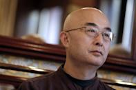Chinese dissident Liao Yiwu attends the promotion of his book about four years in Chinese prisons, on January 16, 2013 in Paris. Liao clearly recalls the moment when he first stepped into a Chinese jail. He was stripped naked by inmates who then searched his anus with chopsticks -- the beginning of his ordeal