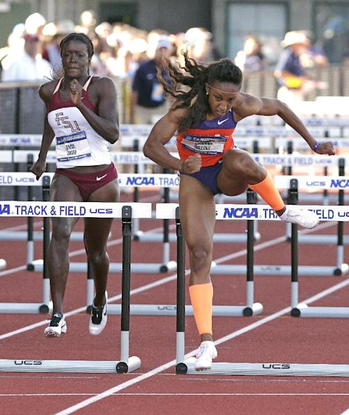 Clemson's Brianna Rollins, right, clears the last hurdle ahead of Florida State's Anne Zagre in the 100-meter hurdle preliminary race during the NCAA Track and Field Championships in Eugene, Ore., Thursday, June 6, 2013. Rollins set a new American collegiate record while Zagre finished eighth. (AP Photo/Don Ryan)