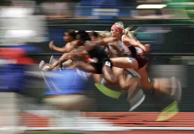 <p>Racers compete during the heptathlon 100-meter hurdles at the U.S. Olympic Track and Field Trials, July 9, 2016, in Eugene Ore. (Photo: Charlie Riedel/AP) </p>