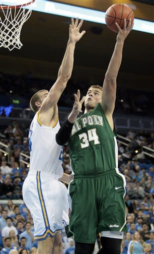 Cal Poly forward Brian Bennett (34) shoots as UCLA's David Wear defends during the first half of an NCAA college basketball game in Los Angeles, Sunday, Nov. 25, 2012. (AP Photo/Jason Redmond)