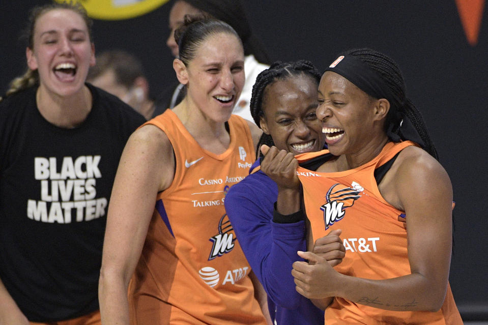 Phoenix Mercury guard Shey Peddy, right, is congratulated by guard Shatori Walker-Kimbrough, second from right, guard Diana Taurasi and forward Alanna Smith, left, after Peddy scored the game-winning shot as time expired against the Washington Mystics during a WNBA basketball first-round playoff game Tuesday, Sept. 15, 2020, in Bradenton, Fla. (AP/Phelan M. Ebenhack)