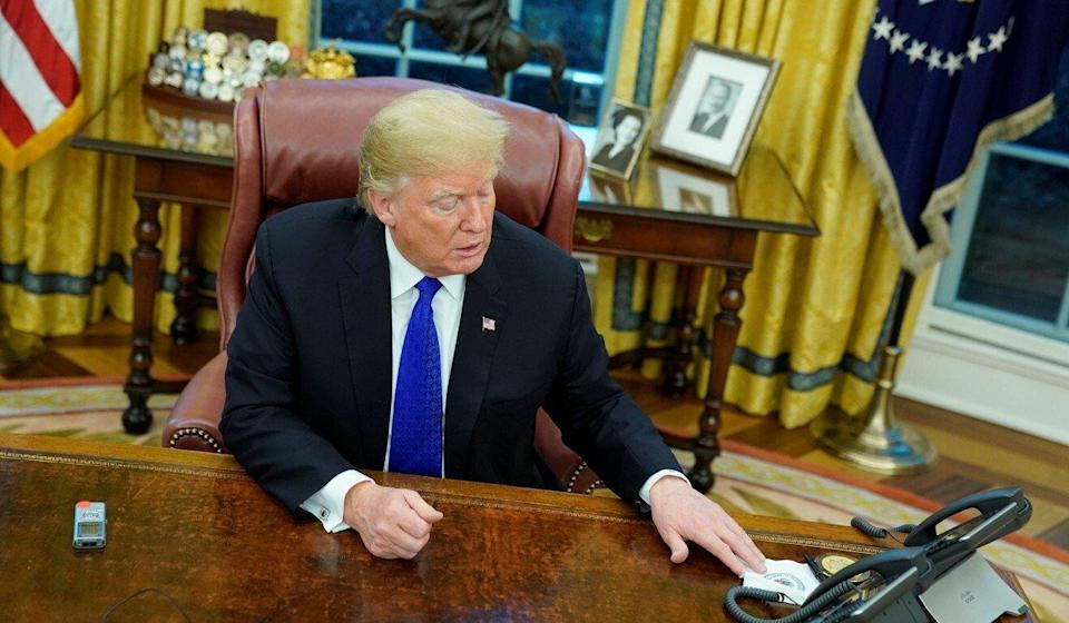 Then-US president Donald Trump, interviewed by Reuters journalists in the Oval Office at the White House on December 11, 2018, said he would intervene in the Meng fraud case if it helped strike a trade deal with China. Photo: Reuters