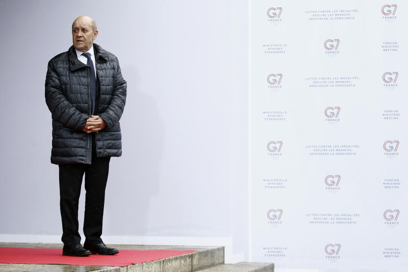 French Foreign Minister Jean-Yves Le Drian awaits US Deputy Secretary of State John J. Sullivan for a G7 meeting at ministerial level in Dinard, Brittany, Friday, April 5, 2019. The G7 meeting is focus on cybersecurity, the trafficking of drugs, arms and migrants in Africa's troubled Sahel region, and fighting gender inequality. (Stephane Mahe/Pool Photo via AP)