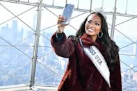 <p>Asya Branch, 2020's Miss U.S.A. smiles for the camera while visiting The Empire State Building in N.Y.C. on Thursday. </p>
