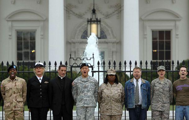 PHOTO: Gay rights activists and gay veterans, including former Army Lieutenant Dan Choi (4th L) and former Marine Corporal Evelyn Thomas (5th L), handcuff themselves to the fence of the White House during a protest Nov. 15, 2010 in Washington, DC. (Alex Wong/Getty Images, FILE)