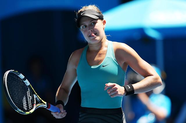 MELBOURNE, AUSTRALIA - JANUARY 21: Eugenie Bouchard of Canada celebrates a point in her quarterfinal match against Ana Ivanovic of Serbia during day nine of the 2014 Australian Open at Melbourne Park on January 21, 2014 in Melbourne, Australia. (Photo by Mark Kolbe/Getty Images)
