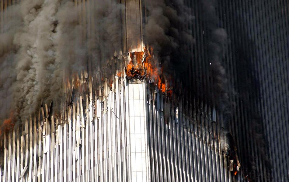The north tower of the World Trade Center is on fire due to a terrorist act of a plane hittng the building in Manhattan, NY. (Photo by Jennifer S. Altman/WireImage) *** Local Caption ***