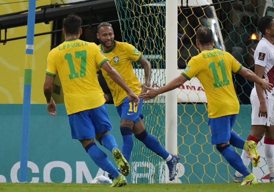 Brazil's Neymar, center, celebrates scoring his side's second goal against Peru during a qualifying soccer match for the FIFA World Cup Qatar 2022 at Pernambuco Arena in Recife, Brazil, Thursday, Sept.9, 2021. (AP Photo/Andre Penner)
