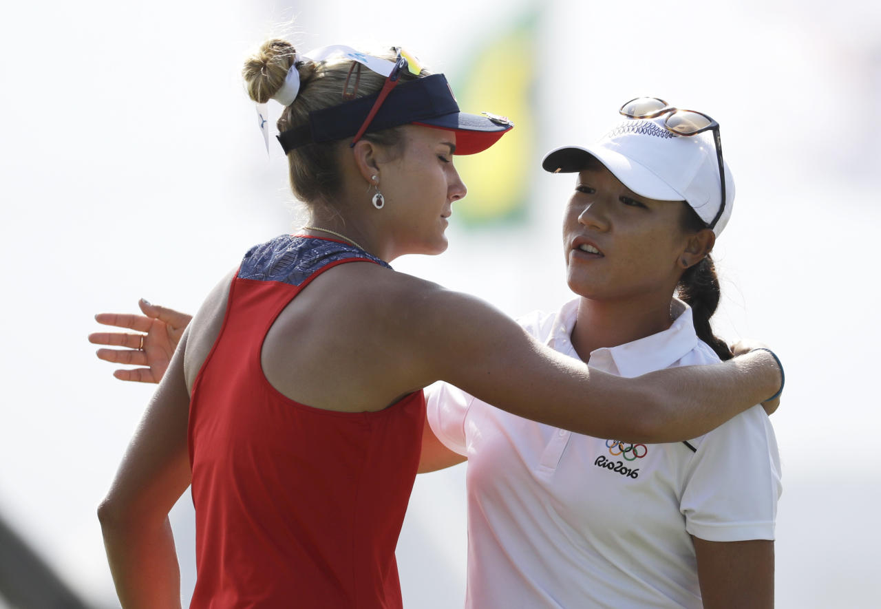 Lydia Ko of New Zealand, right, hugs Lexi Thompson of the United States, left, after they finished their round on the 18th hole during the third round of the women's golf event at the 2016 Summer Olympics in Rio de Janeiro, Brazil, Friday, Aug. 19, 2016. (AP Photo/Chris Carlson)