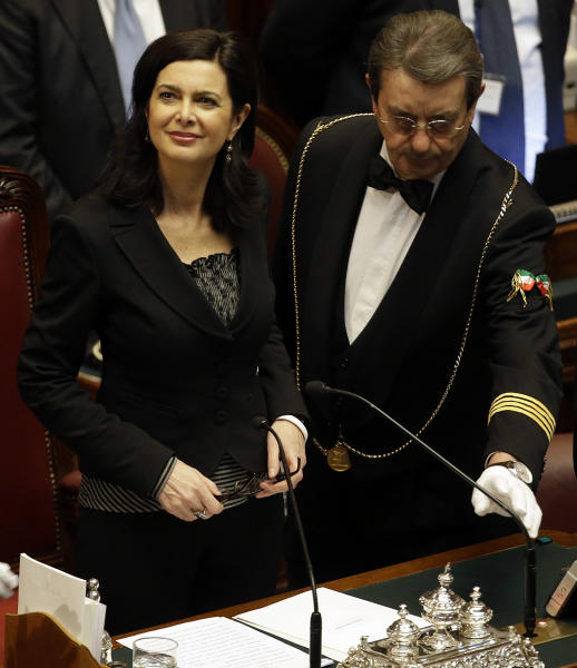 Laura Boldrini, left, acknowledges the applause of lawmakers after being elected President of the Italian lower chamber, at the end of a voting session in Rome, Saturday, March 16, 2013. (AP Photo/Gregorio Borgia)