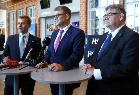 Finland's Finance minister Petteri Orpo, Prime Minister Juha Sipila and Foreign Minister Timo Soini (L-R) speak to media after government's open session for members of public took place during the celebration of the 100th anniversary of Finnish independence in Porvoo, Finland May 4, 2017. REUTERS/Ints Kalnins