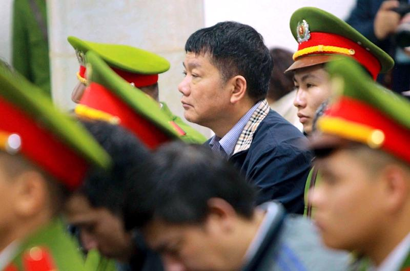 Former Politburo member Dinh La Thang (C), who once chaired the board of PetroVietnam, was sentenced to 13 years in the highest-profile corruption trial to target the country's business and political elite (AFP Photo/Vietnam News Agency)
