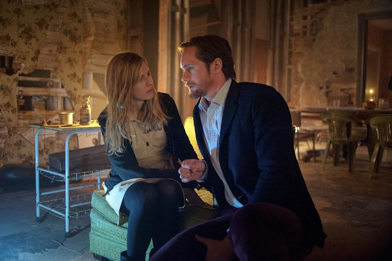 """This film publicity image released by Fox Searchlight Pictures shows Brit Marling, left, and Alexander Skarsgard in a scene from """"The East."""" (AP Photo/Fox Searchlight Pictures, Myles Aronowitz)"""