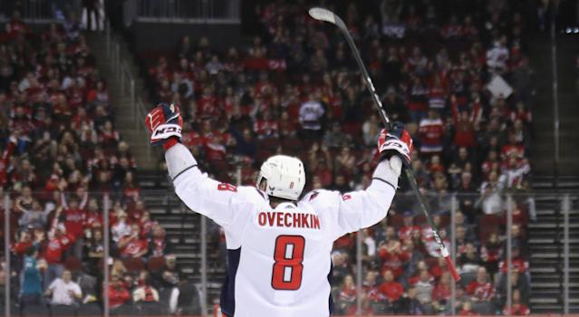 Alex Ovechin's milestone marker, which tied Washington's game against the New Jersey Devils at two on Saturday, was netted in textbook fashion. (Photo by Bruce Bennett/Getty Images)