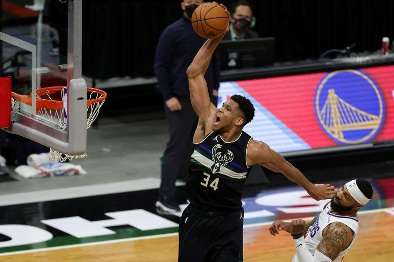 Milwaukee's Giannis Antetokounmpo soars for a dunk in the second half of the Bucks' 105-100 NBA victory over the Los Angeles Clippers.