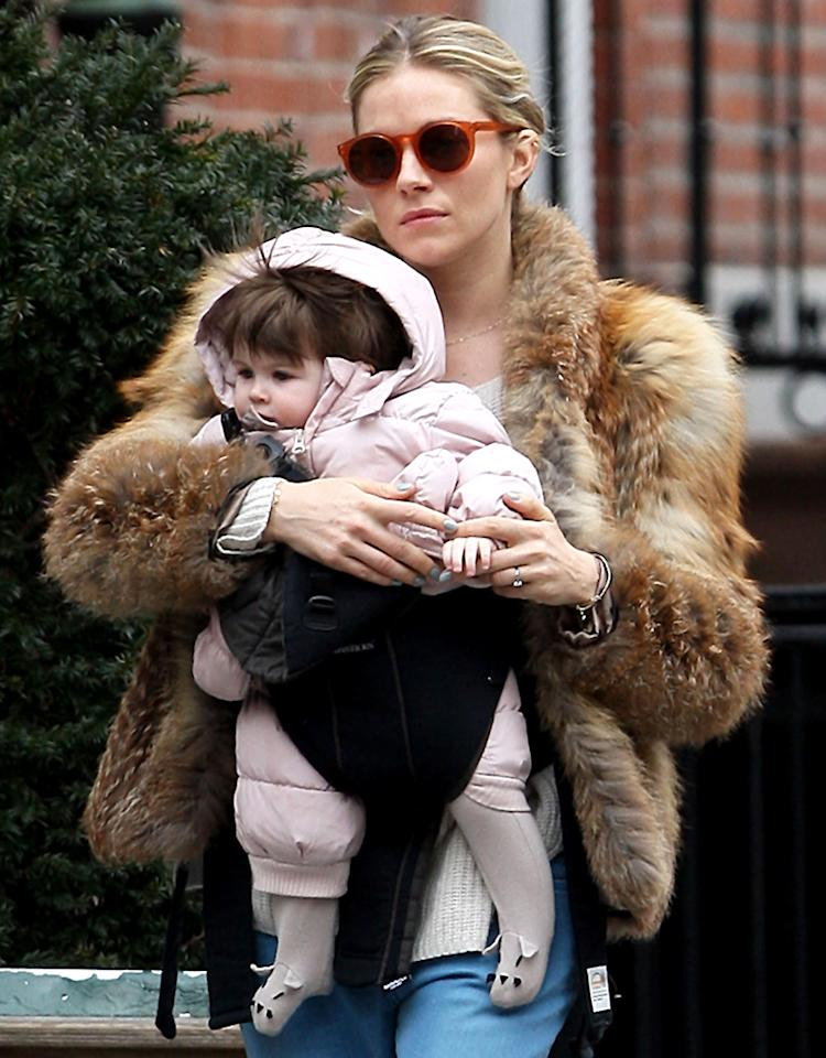 "Baby on board! ""The Girl"" actress Sienna Miller strolled the streets of New York City with her 8-month-old daughter Marlowe as the two played a friendly game of ""Who's got a puffier coat?"" (2/25/2013)"