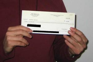 Man holding up a cheque