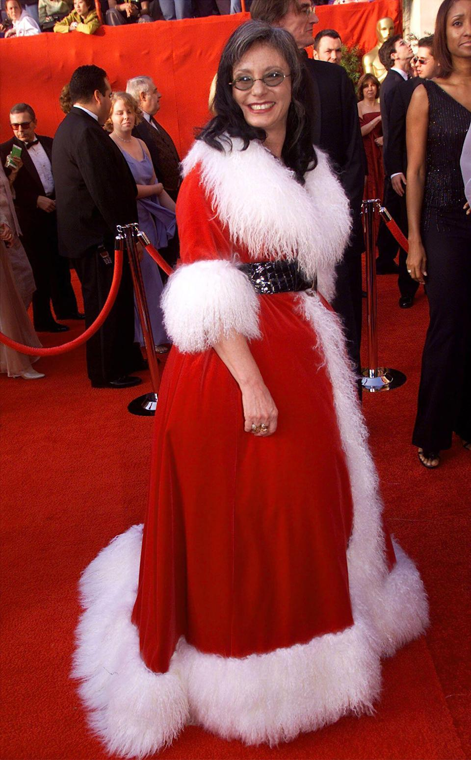 Nominated for best costume design for <em>How the Grinch Stole Christmas</em>, Rita Ryack brought a little bit of holiday spirit (and Whoville) to the Oscars in 2001. She wore a red robe coat trimmed with white shaggy fur—something Mrs. Claus or Martha May Whovier would wear, rather than a Hollywood veteran. She gets an A+ for dedication.