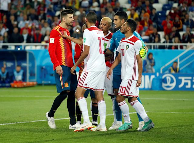 Soccer Football - World Cup - Group B - Spain vs Morocco - Kaliningrad Stadium, Kaliningrad, Russia - June 25, 2018 Spain's Gerard Pique talks with Morocco's Khalid Boutaib, Younes Belhanda and Munir Mohamedi REUTERS/Christian Hartmann