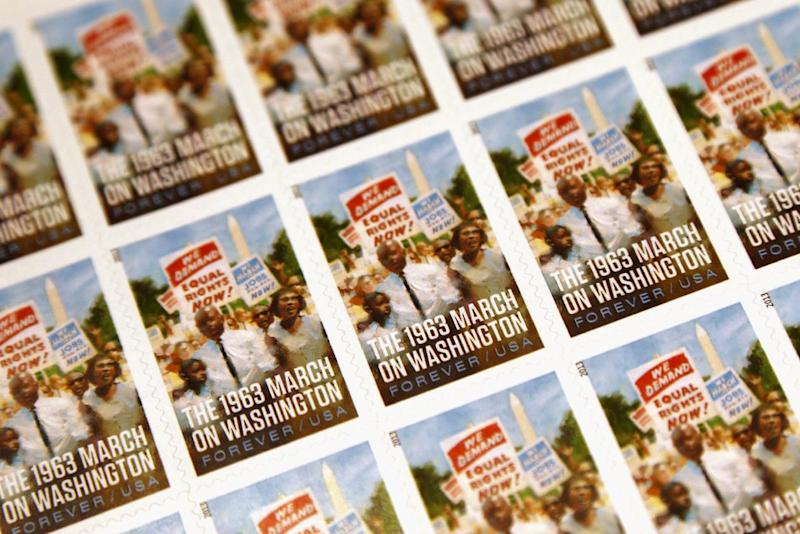 A sheet of the U.S. Postal Service stamp commemorating the 50th anniversary of the March on Washington is seen during an unveiling event at the Newseum in Washington, Friday, Aug. 23, 2013. (AP Photo/Charles Dharapak)