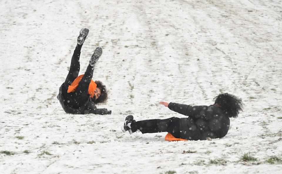 People sledging in a snowy Greenwich Park in London (Photo: PA)