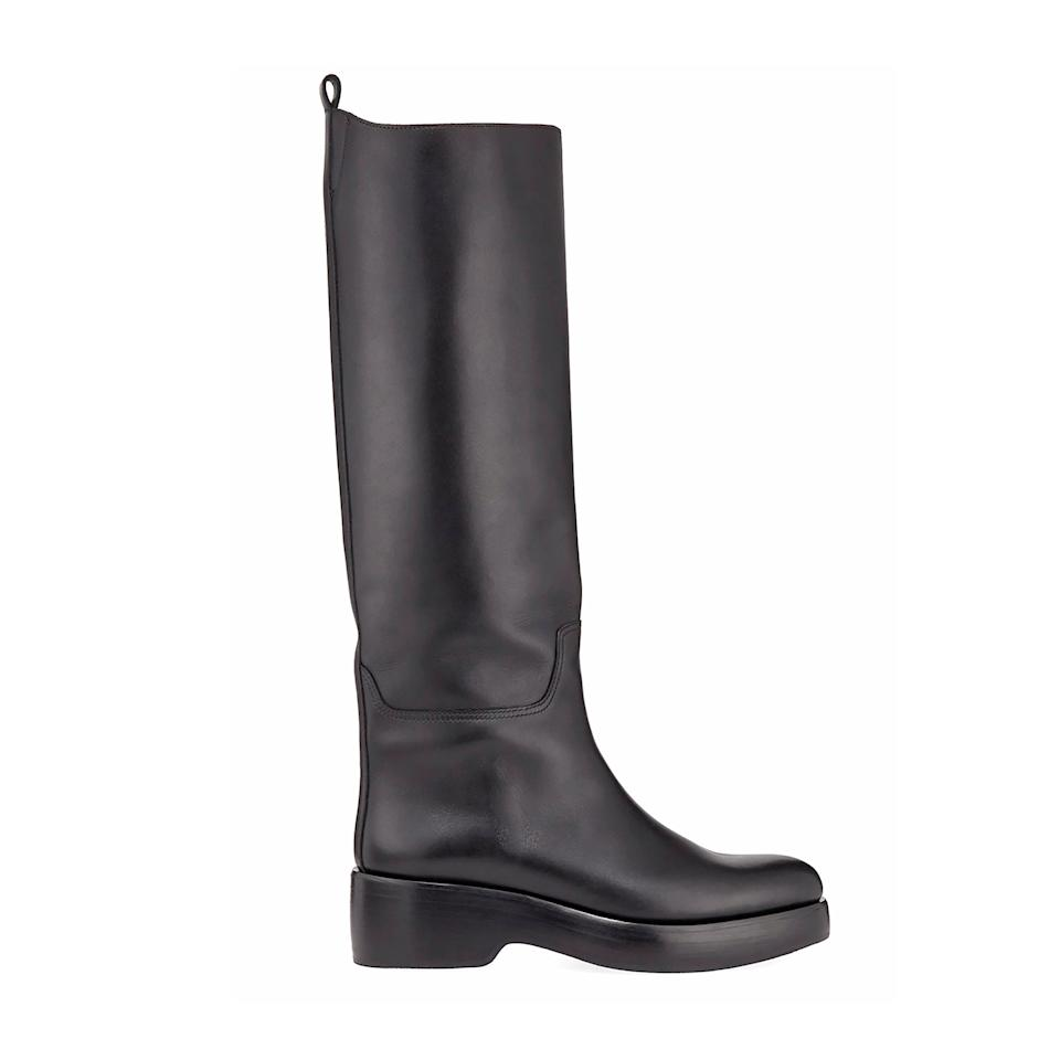 """<p>Embrace the lug sole trend with this streamlined knee-high biker boot.</p> <p><strong>Buy Now:</strong> The Row, black leather biker boot, $2,100, <a href=""""https://www.bergdorfgoodman.com/p/the-row-motorbike-leather-boots-prod149070133?parentId=cat392000&icid=&searchType=EndecaDrivenCat&rte=%252Fcategory.jsp%253FitemId%253Dcat392000%2526pageSize%253D30%2526Nao%253D0%2526refinements%253D&eItemId=prod149070133&cmCat=product"""">bergdorfgoodman.com</a></p>"""