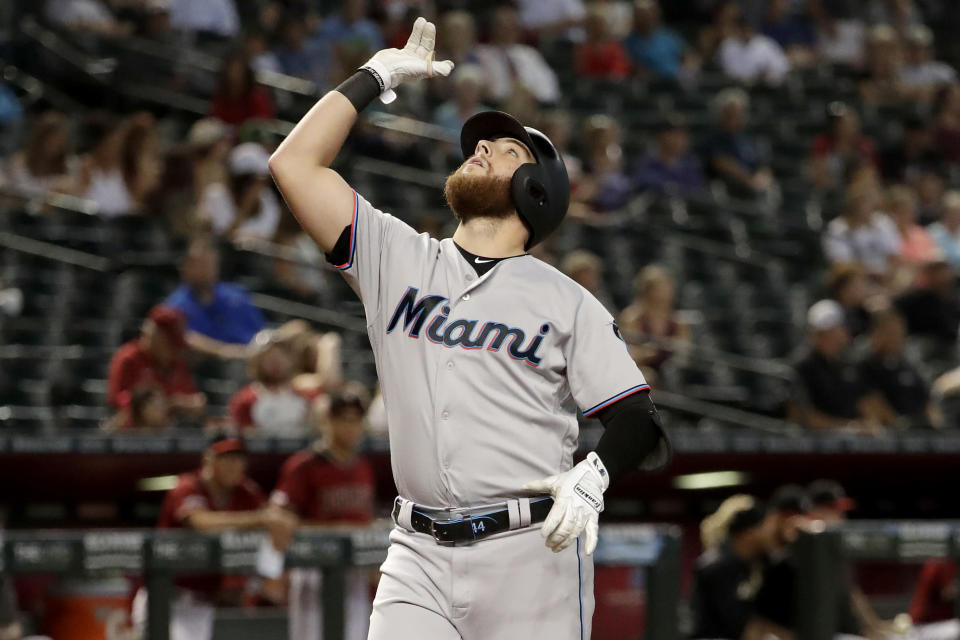 Miami Marlins' Austin Dean crosses the plate after hitting a solo home run during the fourth inning of a baseball game abasing the Arizona Diamondbacks, Wednesday, Sept. 18, 2019, in Phoenix. (AP Photo/Matt York)