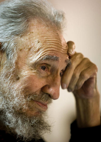 FILE - In this Feb. 10 2012 file photo released by the state media website Cubadebate, Cuba's leader Fidel Castro smiles during a meeting with intellectuals and writers at the International Book Fair in Havana, Cuba. On Monday Aug. 13, 2012, Cuba is marking Fidel Castro's 86th birthday with congratulatory messages in state media but no apparent plans for a public appearance by the retired leader. (AP Photo/Cubadebate, Roberto Chile, File)