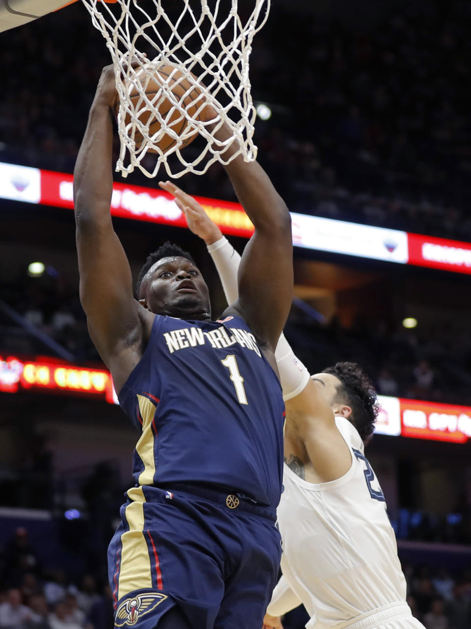 New Orleans Pelicans forward Zion Williamson (1) goes to the basket next to Memphis Grizzlies guard Dillon Brooks during the first half of an NBA basketball game in New Orleans, Friday, Jan. 31, 2020. (AP Photo/Gerald Herbert)