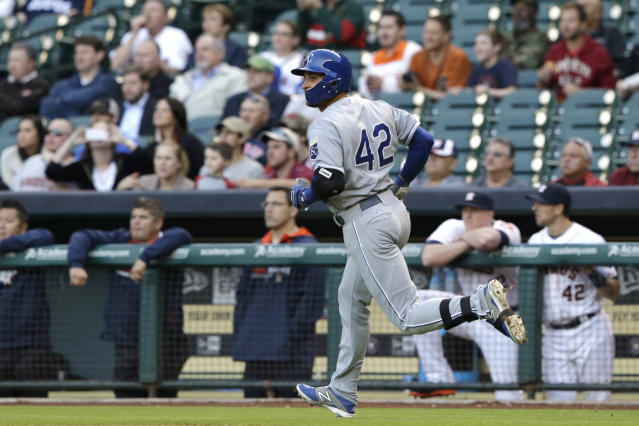 Kansas City Royals' Omar Infante rounds the bases in front of the Houston Astros dugout on a solo home run in the first inning of a baseball game Tuesday, April 15, 2014, in Houston. (AP Photo/Pat Sullivan)