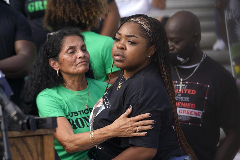 Mona Hardin, left, mother of Ronald Greene, hugs LaChay Batts, sister of Marvin Scott III, who died in custody in a Collin County, Texas jail in 2021, as they participate in a rally outside the state Capitol, Thursday, May 27, 2021, in Baton Rouge, La., protesting the death of Greene, who died in the custody of Louisiana State Police in 2019. (AP Photo/Gerald Herbert)