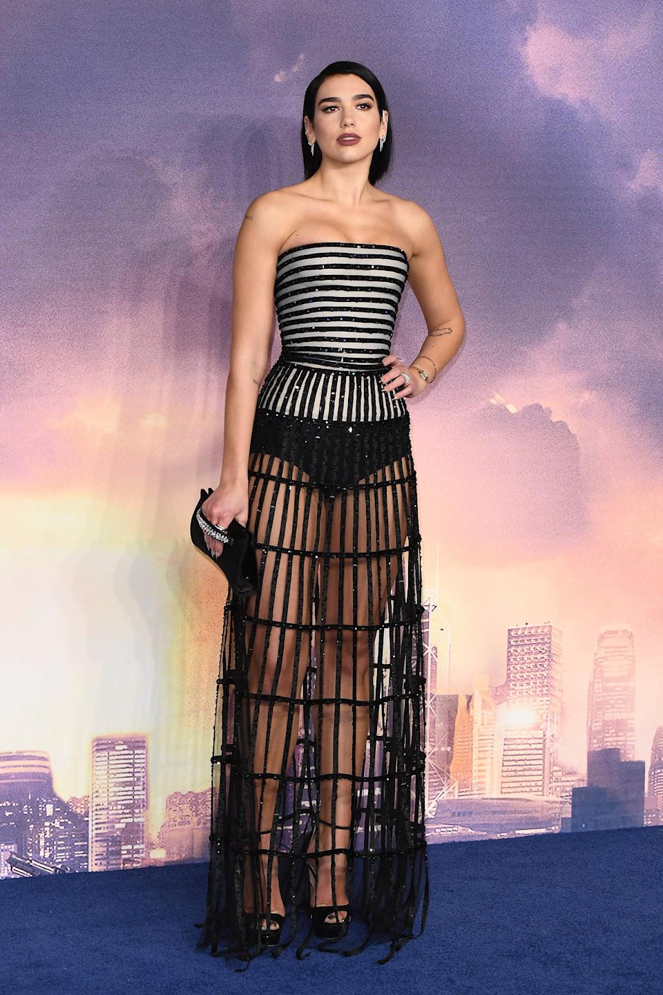 <p>Wearing a black sheer net dress by Armani Privé at the premiere of <strong>Alita: Battle Angel</strong>.</p>