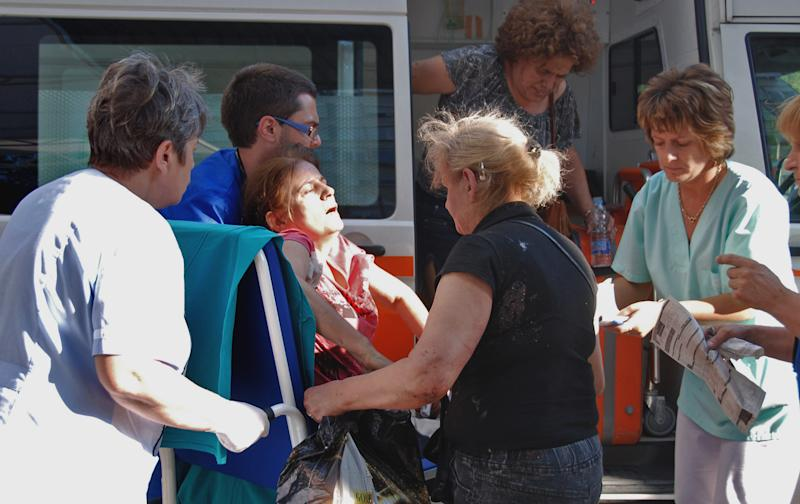 An unidentified injured Israeli tourist is carried in front of Borgas hospital after an explosion at Burgas airport, outside the Black Sea city of Burgas, Bulgaria, some 400 kilometers (250 miles) east of the capital, Sofia, Wednesday, July 18, 2012. A bus carrying young Israeli tourists in a Bulgarian resort exploded Wednesday, killing three people and wounding at least 20, police said. Witnesses told Israeli media that the huge blast occurred soon after someone boarded the vehicle. (AP Photo/ Bulphoto Agency) BULGARIA OUT