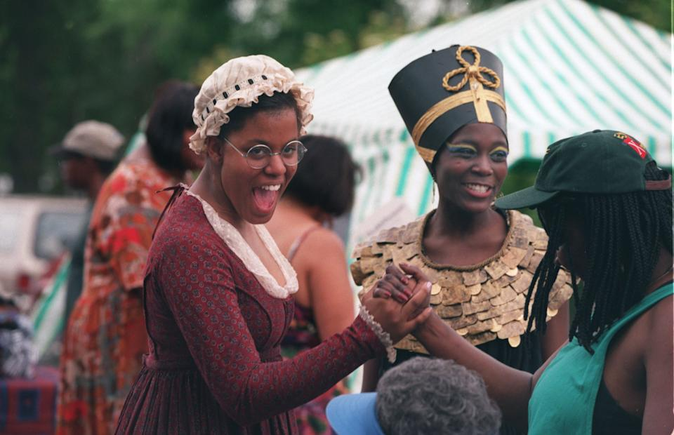 Quiaira Tarver 16, left dressed as Phyllis Wheatley and Anna Otieno 15  as