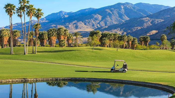 Late afternoon light cast a warm glow to a golf course in Palm Springs, California.