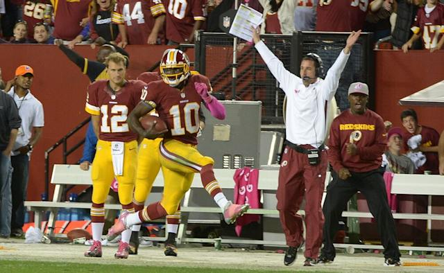 The good times rolled during RG3's rookie year, for the quarterback and the offensive cooridnator, Kyle Shanahan (in white). | Jonathan Newton / The Washington Post/Getty Images