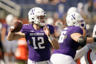 Northwestern quarterback Peyton Ramsey (12) looks for a receiver against Auburn during the first half of the Citrus Bowl NCAA college football game, Friday, Jan. 1, 2021, in Orlando, Fla. (AP Photo/John Raoux)