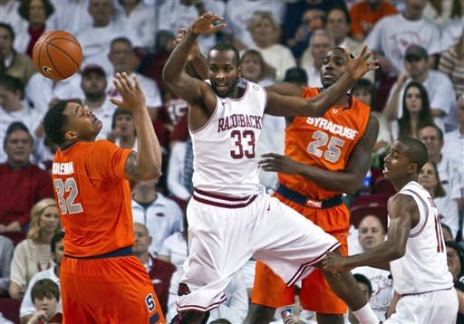 Arkansas' Marshawn Powell (33) and Syracuse's DaJuan Coleman (32) and Rakeem Christmas (25) react to a deflected ball as Arkansas' B.J. Young, right, watches during the first half of an NCAA college basketball game in Fayetteville, Ark., Friday, Nov. 30, 2012. (AP Photo/Gareth Patterson)