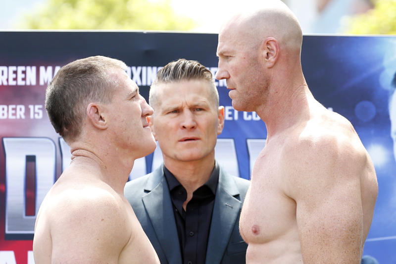 Paul Gallen and Barry Hall face off during the Official Weigh In.