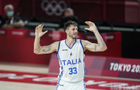 Italy's Achille Polonara (33) reacts after missing a shot during men's basketball preliminary round game against Nigeria at the 2020 Summer Olympics, Saturday, July 31, 2021, in Saitama, Japan. (AP Photo/Charlie Neibergall)