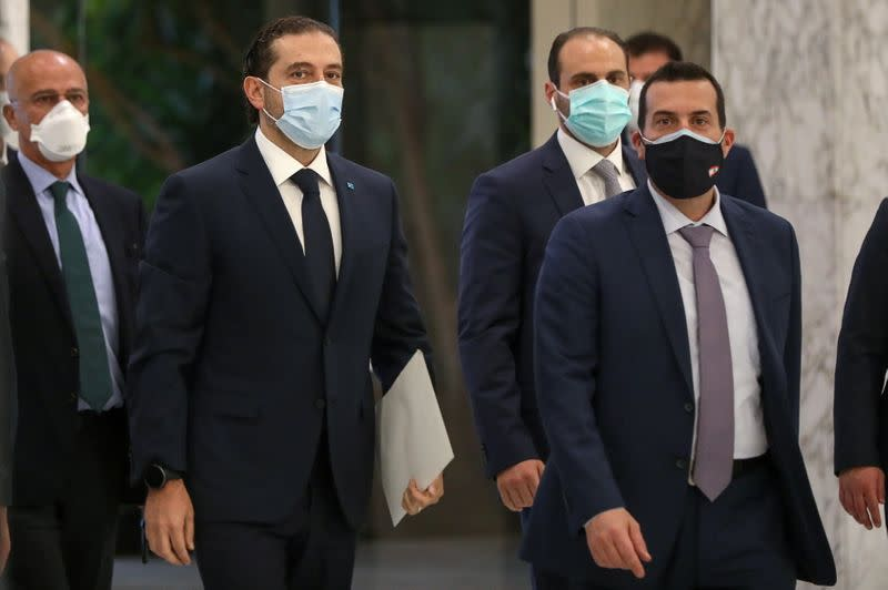Prime Minister-designate Saad al-Hariri arrives to meet with Lebanon's President Michel Aoun at the presidential palace in Baabda