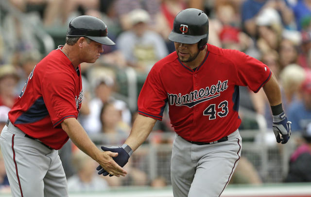 Minnesota Twins' Josmil Pinto (43) is greeted by third base coach Joe Vavra after hitting a home run during the seventh inning of an exhibition baseball game against the Boston Red Sox in Fort Myers, Fla., Saturday, March 29, 2014. The Twins won 7-4. (AP Photo/Gerald Herbert)