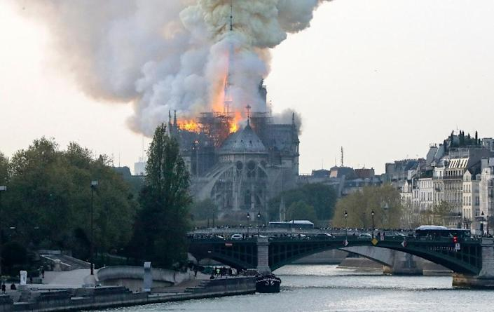 A spokesman for the cathedral told AFP that the wooden structure supporting the roof was being gutted by the blaze. (AFP Photo/FRANCOIS GUILLOT)