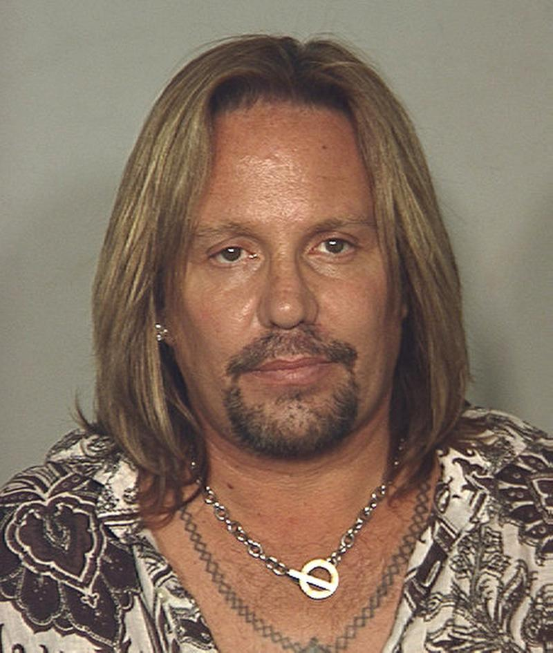 FILE - This file photo released by the Las Vegas Metropolitan Police Department shows Motley Crue singer Vince Neil who was arrested in Las Vegas on a drunken driving charge early Monday, June 28, 2010. According to the Las Vegas Review Journal Monday, Oct. 31, 2011, Neil plans to plead guilty to a misdemeanor disorderly conduct charge, pay a $1,000 fine and avoid a trial on on allegations  that he poked his ex-girlfriend in a confrontation last March in a Las Vegas resort lounge. (AP Photo/Las Vegas Metropolitan Police Department, File)