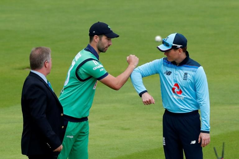 Good luck - Ireland captain Andy Balbirnie (L) bumps arms with England captain Eoin Morgan (R) after Ireland won the toss and elected to bat during the second One-Day International at Southampton on Saturday