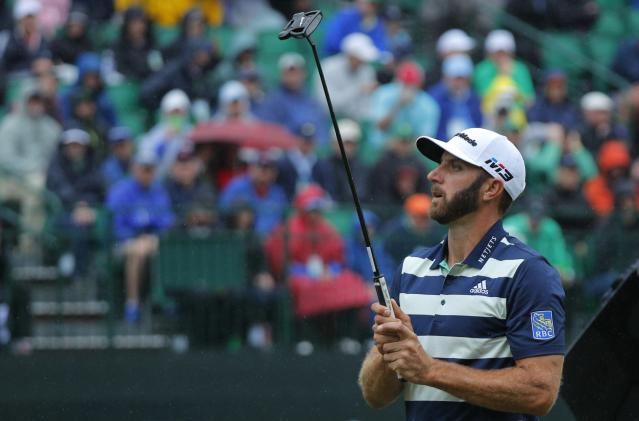 Dustin Johnson of the U.S. reacts to missing a putt on the 14th green during third round play of the 2018 Masters golf tournament at the Augusta National Golf Club in Augusta, Georgia, U.S. April 7, 2018. REUTERS/Brian Snyder